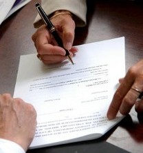 People Signing Document - Real Estate Law